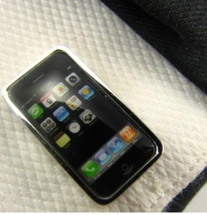 Manchetknoop mobiele telefoon