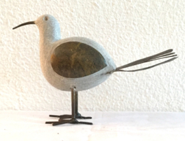 Vogel, spingstone en scrap metal.