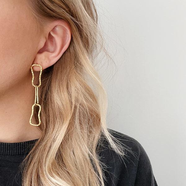 Statement oorbellen schakel goud