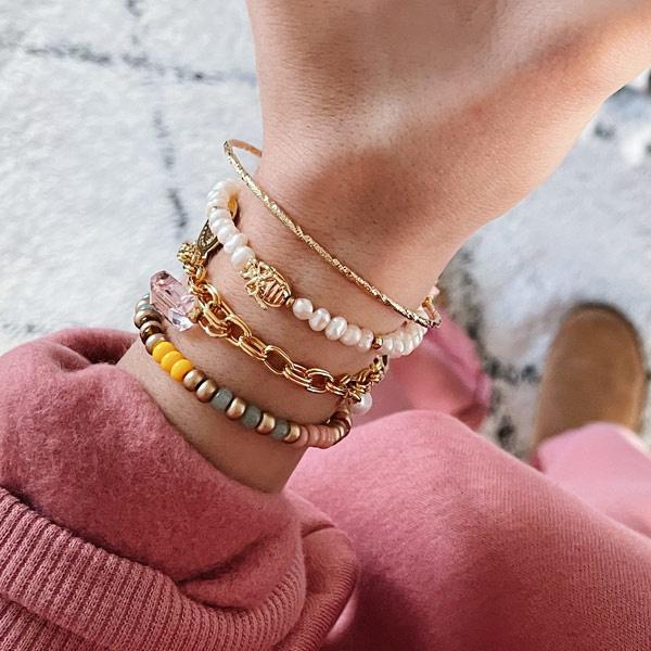 Armband bangle goud koord roze