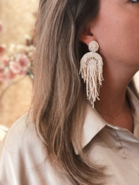Statement earrings off white