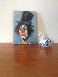 Kleine decoratie. Clown met hoed en bloem.