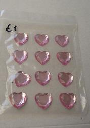 Roze hartjes  (vel met 12 hartjes ) 1,5 x 1,5 cm