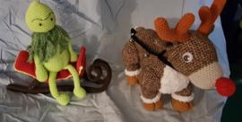 Grunch op een arreslee met Reindier