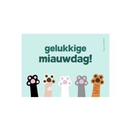 Wenskaart 'Gelukkige Miauwdag!' - 5 vrolijke pootjes in de lucht