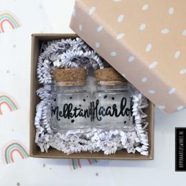 Haarlokje en melktandjes potjes in luxe cadeauverpakking poederroze
