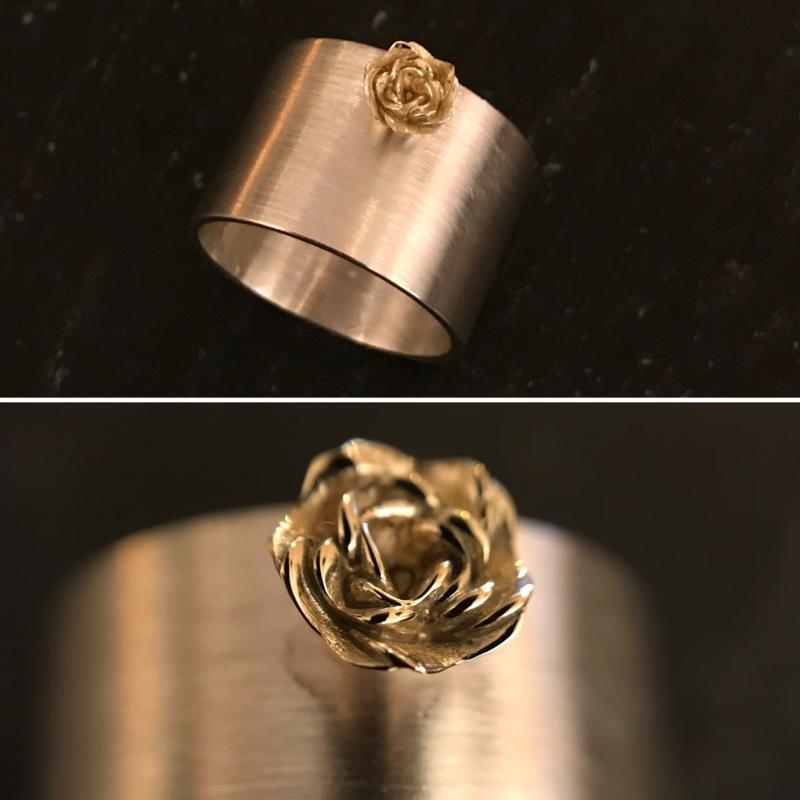 zilveren ring met gouden roos
