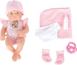 Baby met een deken en accessoires