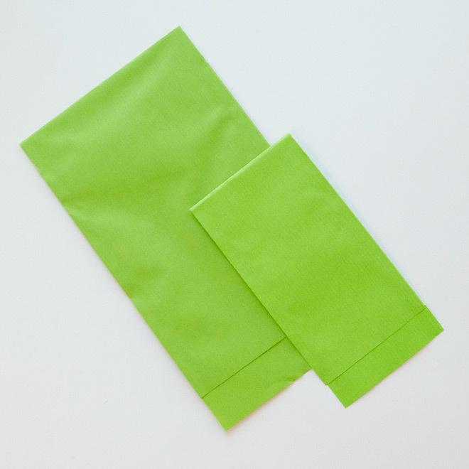 Grasgroene papieren zakjes