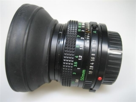 Canon Lens-FD50 mm 1 : 1.8 met zonkap