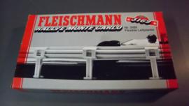 Fleischmann Auto-Rallye.  Flexibele vangrails + klemmen nr. 3169 in OVP grijs.  Old New Stock.