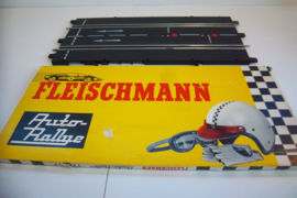 Fleischmann Auto-Rallye. Aansluitbaanstuk met rondenteller 3117. in ovp geel