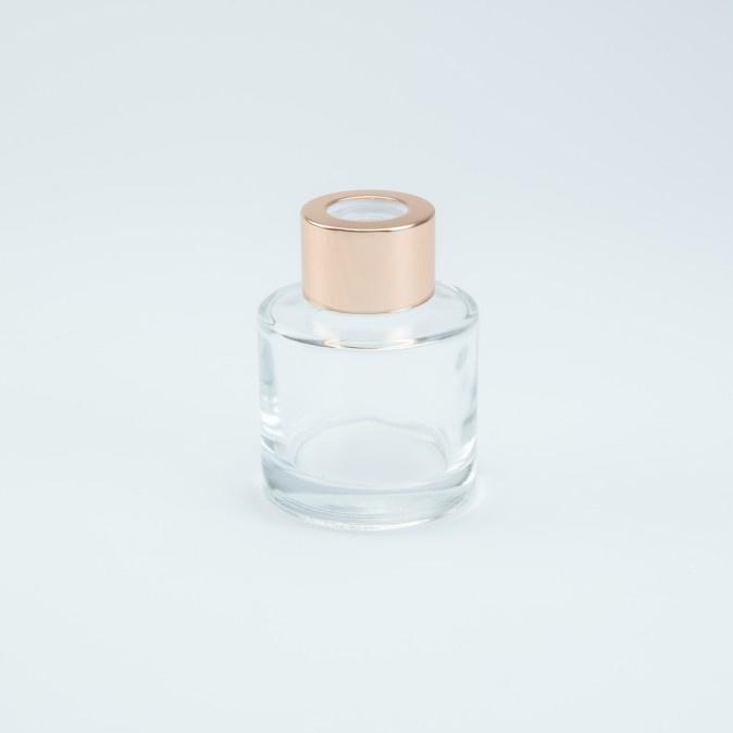 Glazen huisparfum met rosé dop