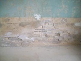 stucwerk laat los (binnenmuur)