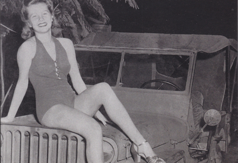 Pin-up seated on army Jeep, DIN A6-size, unused, Dutch issue, 2008