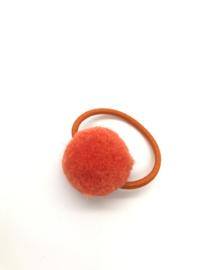 Elastiekje pompon oranje