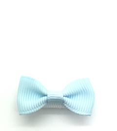 Klittenbandspeldje met strikje lichtblauw