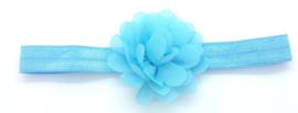Babyhaarbandje met bloem lichtblauw