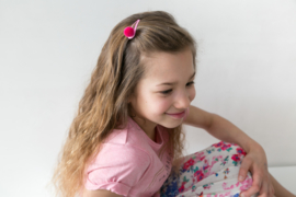 Haarspeldje met pompon roze