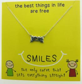 Zilveren geschenk SMILES