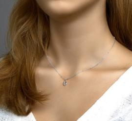 uitgebreide zilveren set: collier, armband en oorbellen schelp