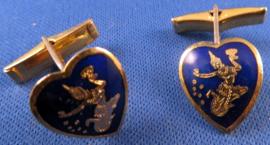 Goudkleurige manchetknopen met dansende figuur