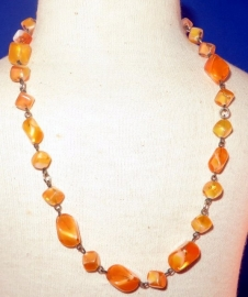 Transparant licht oranje glaskralen ketting