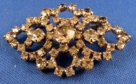 Broche van metaal met strass stenen