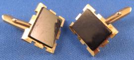Goudkleurige manchetknopen met zwart kunststof