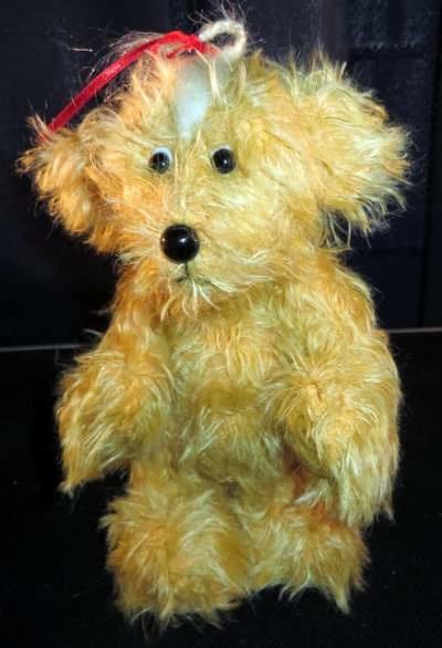 Antieke pluche speelgoed hond