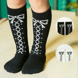 Kniekousen met strikjes zwart en wit