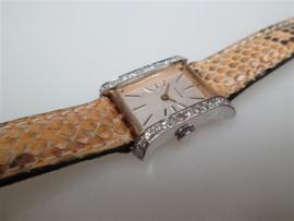 Zwitsers goud 14 krt. klassiek dames horloge met 24 briljanten ca.1963