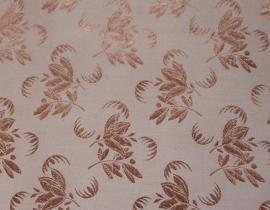 Jacquard coutill koper met rose gouden bloem 142 cm breed. (prijs per 50 cm.)