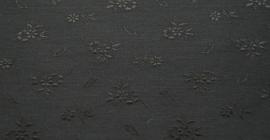 Jacquard coutill zwart met kleine bloem 142 cm breed. (prijs per 50 cm.)