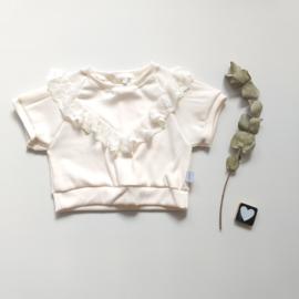 Creme sweater rib kanten ruffel