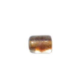 Doorzichtige cilinder van glas met binnenin bruin