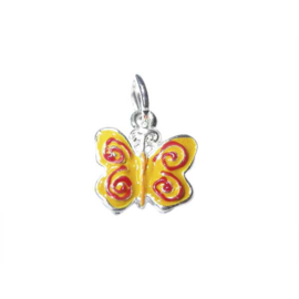 Butterfly charm made of metal with yellow and red