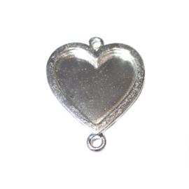 Metalen hartvormige hanger met aan de boven en de onderkant een oogje