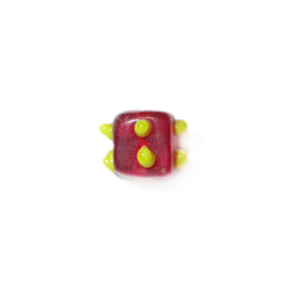 Red, square glass bead with yellow dots