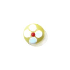 Gele platte glaskraal met witte, blauwe en rode uitsteeksels