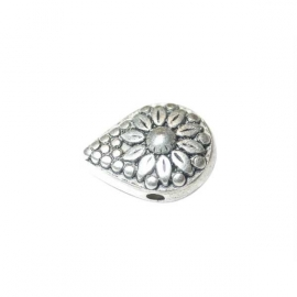 Dropform bead, decorated with a flower.