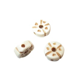 Cream coloured bone bead with decoration
