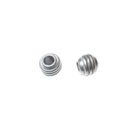Little silver colored metal bead with stripes