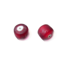 Red glass bead with white inside