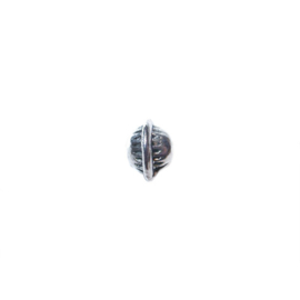 Silver colored metal bead in discus form