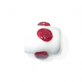 Witte cilinder van glas met rode dots