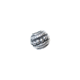 Silver colored metal bead with decoration