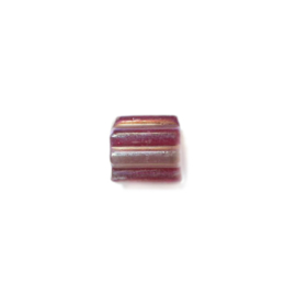 Glass bead with one half red and one half transparent red