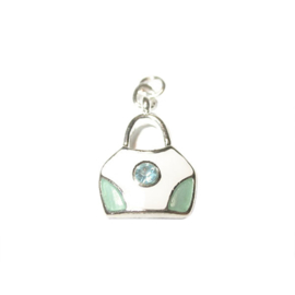 Bag charm made of metal with cream color and light blue