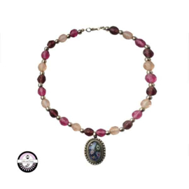 Necklace made with Metalcolured, decorated pendant with pink glass